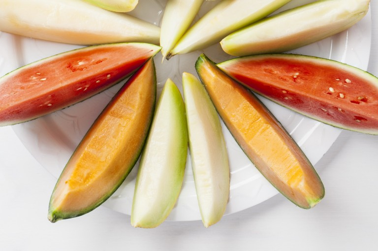 Colourful melon types on a plate